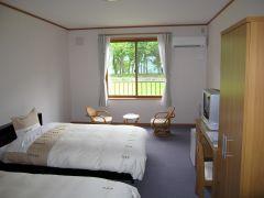 洋室:ツインベッドタイプの客室